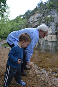 Grandpa and Van checking out rocks along the Buffalo River